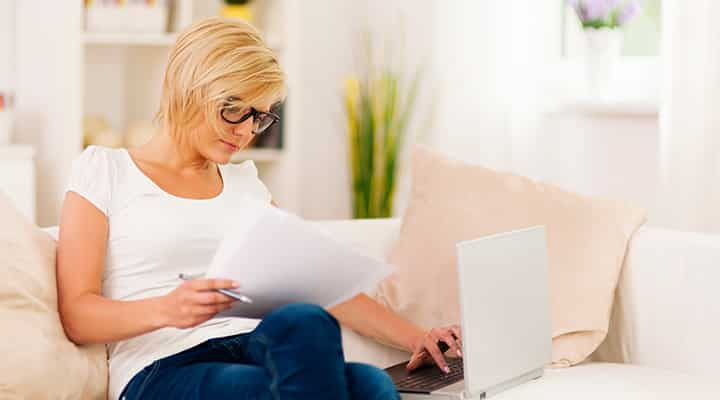 Woman working at home with a laptop